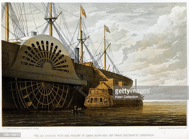 Illustration of the old frigate Iris with her freight of cable alongside the Great Eastern at Sheerness The TransAtlantic telegraph cable passed from...