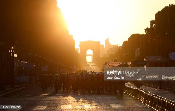 Illustration of the pack at sunset on the Champs Elysees during stage 21 of the 106th Tour de France 2019, the last stage from Rambouillet to Paris -...