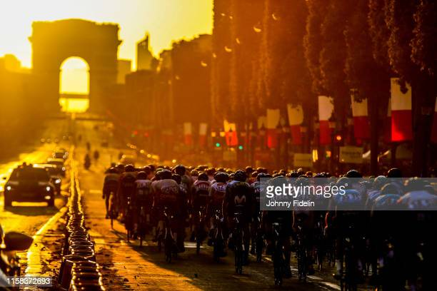 Illustration of the pack at sunset on the Champs Elysees with the Arc de Triomphe during the Stage 21 of Tour de France from Rambouillet to Paris...