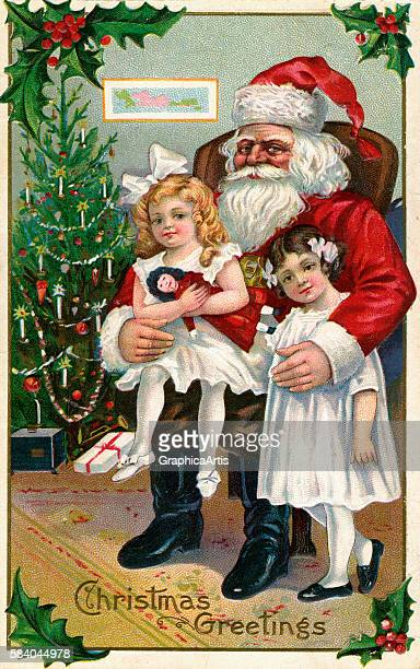 Illustration of Victorian girls sitting on the lap of Santa Claus by a Christmas tree 1900 Chromolithograph