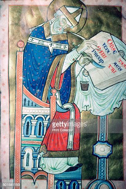 Illustration painted at Canterbury of St Dunstan as a scribe part of a latin commentary on the rule of St Benedict This piece is from the British...