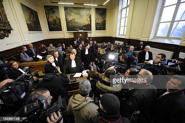 Illustration photo shows journalists and photographers gathering in court at the Tournai courthouse on December 1 on the first day of trial of...