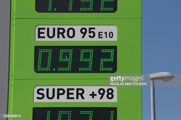 Illustration picture shows a board with the price of Eurosuper below one euro for the first time since years in Brakel Thursday 26 March 2020 From...