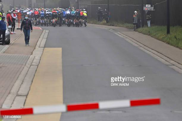Illustration picture shows a closed railway level crossing just behind the pack of the riders during the men's elite race of the 'Omloop Het...
