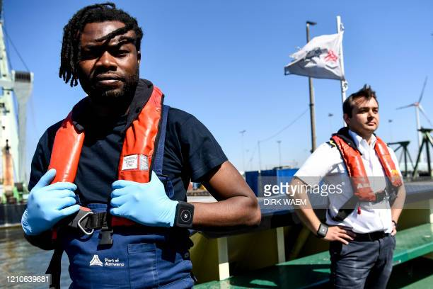 Illustration picture shows a deck hand and a captain during the presentation of the Romware Covid Radius on the Romware One bracelet at the Port of...
