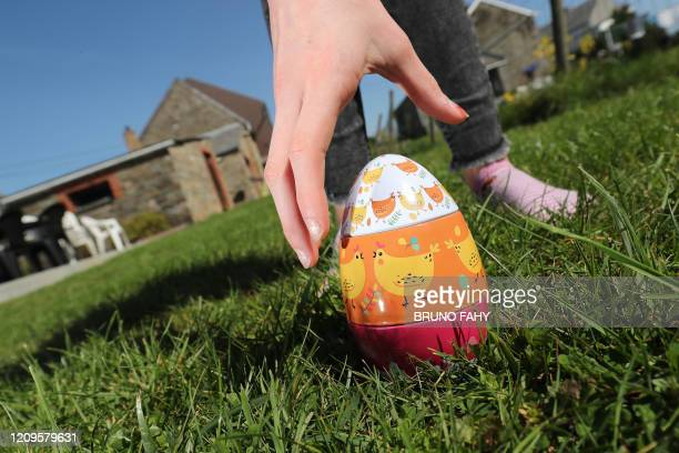 Illustration picture shows a girl searching for Easter eggs, in the garden, in Vezin, Friday 10 April 2020. Belgium goes into its fourth week of...