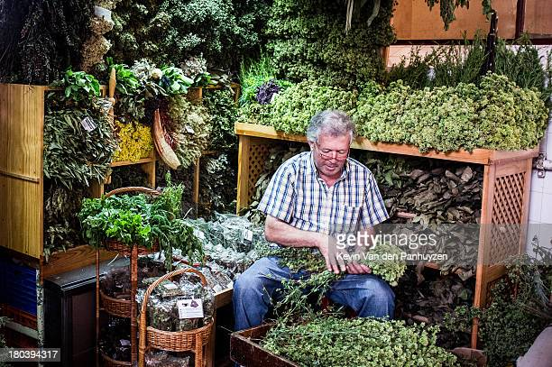 CONTENT] Illustration picture shows a herb seller tying dried herbs together on a market in Funchal This market Mercado dos Lavradores draws lots of...