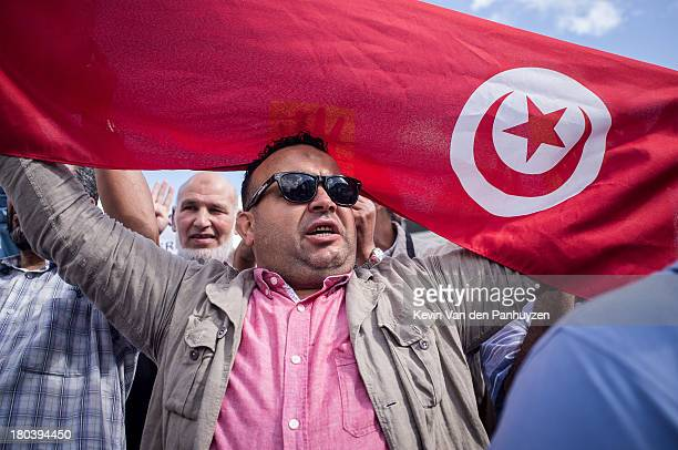 Illustration picture shows a pro Morsi protester holding a flag of Tunisia in Brussels, 18th august 2013. Hundreds gathered in the center of the...