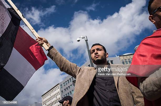 Illustration picture shows a pro Morsi protester holding a flag of Egypt in Brussels, 18th august 2013. Hundreds gathered in the center of the...
