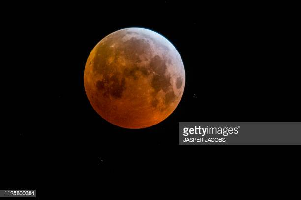 Illustration picture shows a total lunar eclips and bloodmoon over the sky in Mechelen in the morning of Monday 21 January 2019 The entire event was...