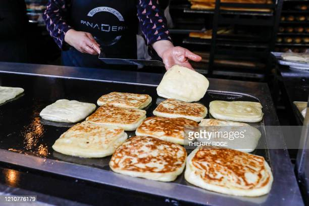 Illustration picture shows a woman preparing m'semen at La Panaderia in Molenbeek as lots of people observing the Ramadan come to buy bread at the...