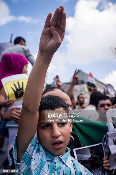 Illustration picture shows a young protester in Brussels, 28th july 2013. Hundreds gathered on the Schuman place in the center of the European...