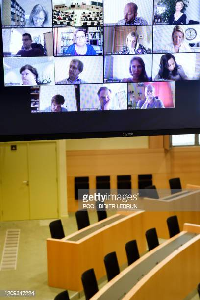 Illustration picture shows an empty room with a large screen with a video conference call with Minister of Health Social Affairs Asylum Policy and...