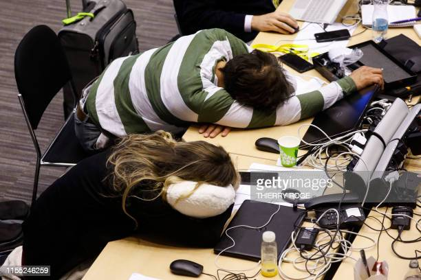 Illustration picture shows journalists sleeping during a night of negociation at EU summit meeting Monday 01 July 2019 at the European Union...