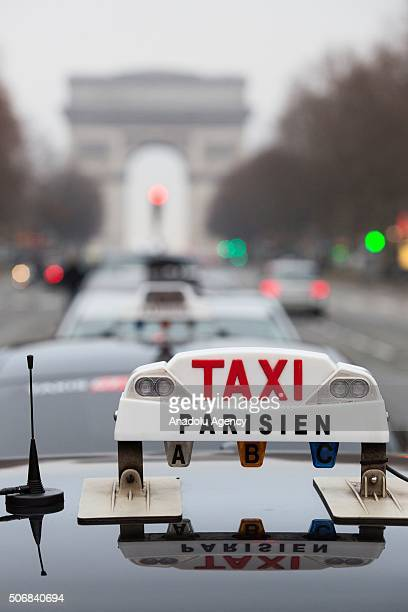 illustration picture shows Parisian taxis in front of Arc de Triomphe in Paris France on January 26 2016 French taxi drivers are protesting against...