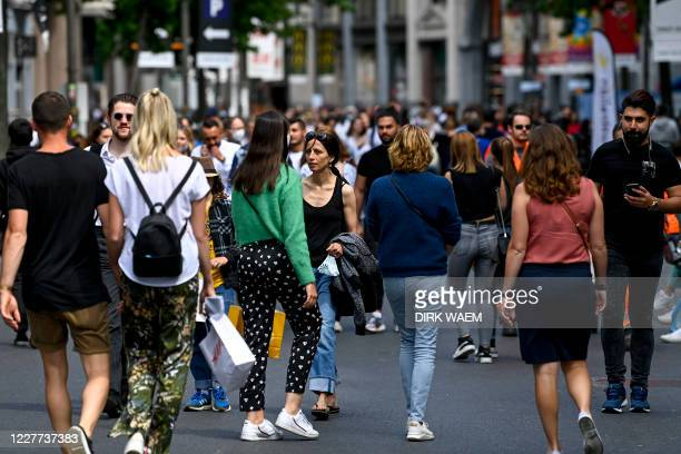 Illustration picture shows people wearing face masks in the city center of Antwerp, Wednesday 22 July 2020. The reported Covid-19 contaminations are...