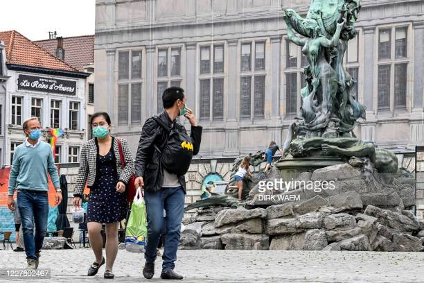 Illustration picture shows persons wearing masks in the city center of Antwerp, Monday 27 July 2020. The Covid-19 contamination numbers are rising...