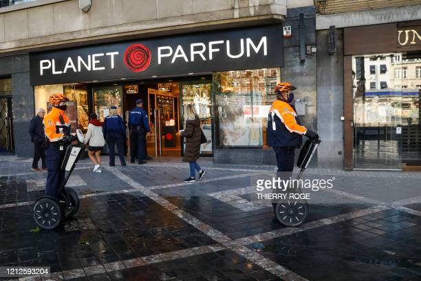 Illustration picture shows police officers patroling on a Segway at the Avenue Louise shopping neighbourhood in Brussels, Monday 11 May 2020. Belgium...