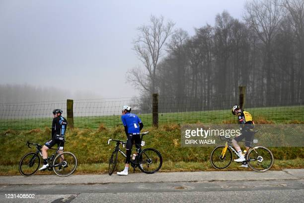 Illustration picture shows riders at the side of the road during the men's elite race of the 'Omloop Het Nieuwsblad' one-day cycling race, 201km from...