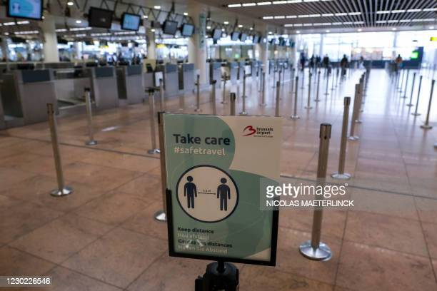 Illustration picture shows rules for safe travel inside the departure hall of Brussels Airport in Zaventem, Sunday 20 December 2020. Belgium advise...