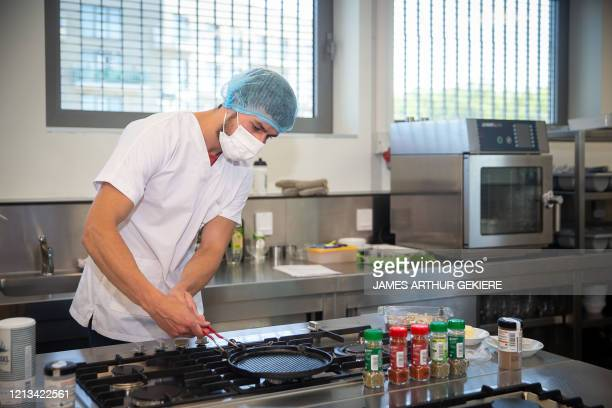 Illustration picture shows students during their practical cooking lessons at the Technologiecampus Gent campus of the Odisee college, Monday 18 May...