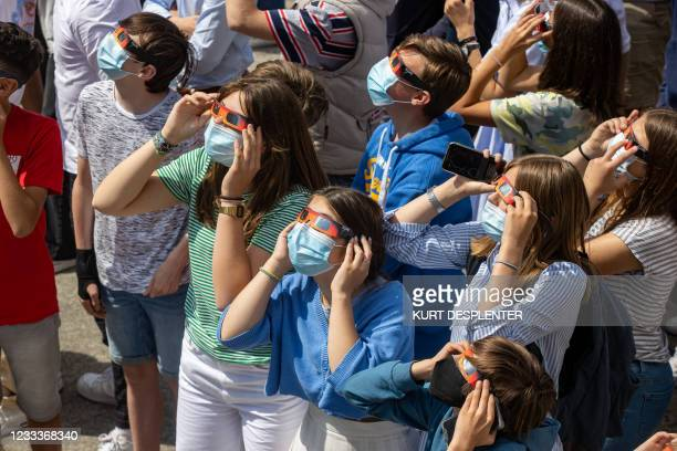 Illustration picture shows Students from the Broeders' School looking at a partial lunar eclipse, in Roeselare, Thursday 10 June 2021. The phenomenon...