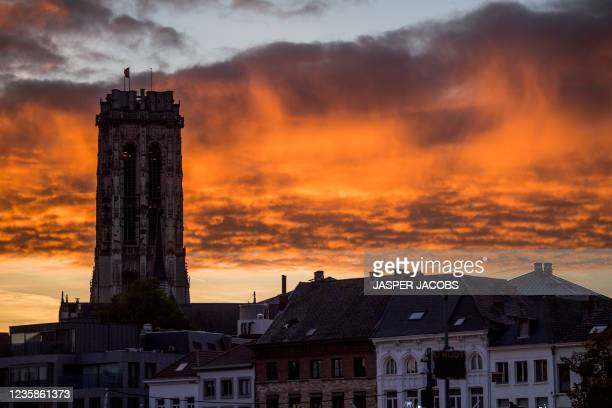 Illustration picture shows the Sint-Romboutstoren with a sunset after a session of the Criminal Court in Mechelen in the trial of television producer...
