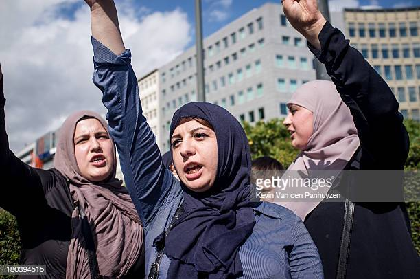 Illustration picture shows three female pro Morsi protesters in Brussels, 18th august 2013. Hundreds gathered in the center of the European quarter...
