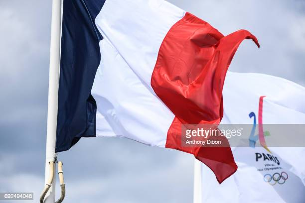 Illustration picture with the franch flag et Paris 2024 flag during the day 9 of the French Open at Roland Garros on June 5 2017 in Paris France