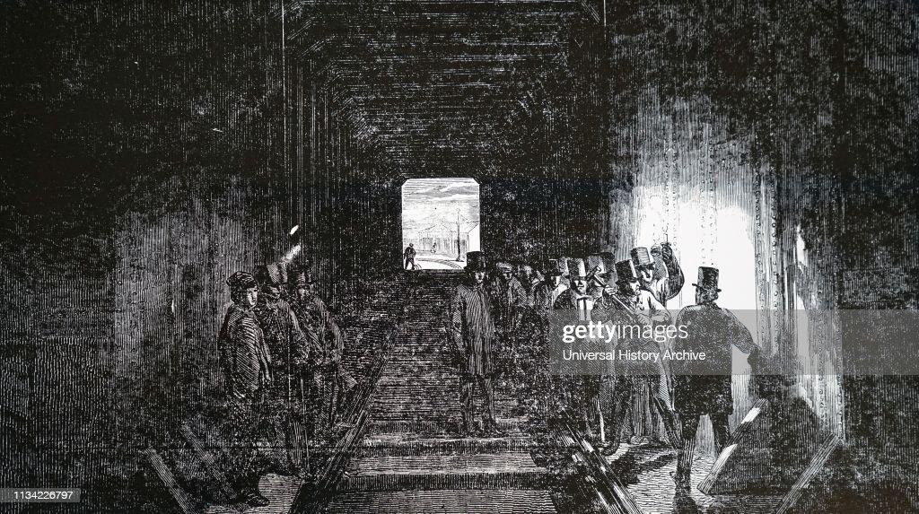 Illustration showing Robert Stephenson driving the last rivet of the Britannia tubular bridge : News Photo