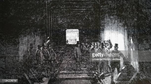 Illustration showing Robert Stephenson driving the last rivet of the Britannia tubular bridge over the Menai Straits it was opened for traffic on 18...