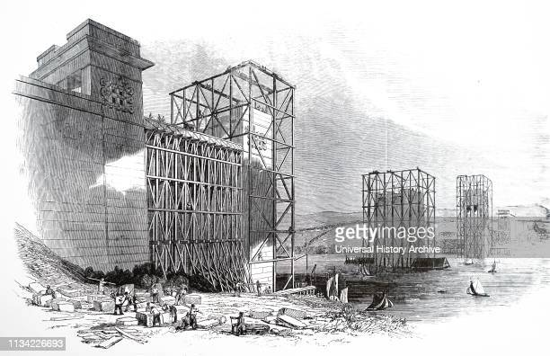 Illustration. Showing The Britannia tubular bridge over the Menai Straits. In the course of construction. Built by Robert Stephenson. Work was begun...