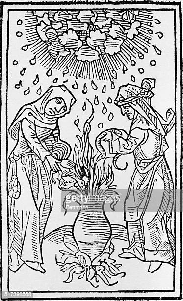 Illustration showing two witches brewing up a bewitching concoction to heal all ills of the soul and body Woodcut from a book on alchemy published in...