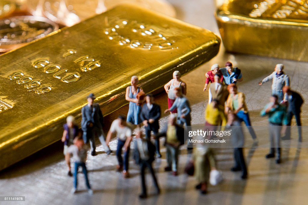 Illustration shows people in front of gold bars on February 16, 2016 in Muenchen, Germany.
