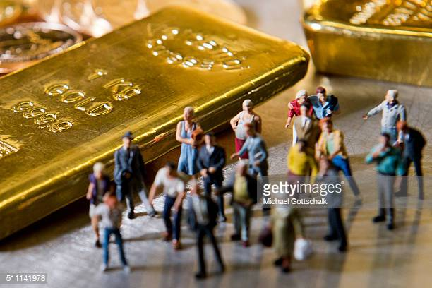 Illustration shows people in front of gold bars on February 16 2016 in Muenchen Germany
