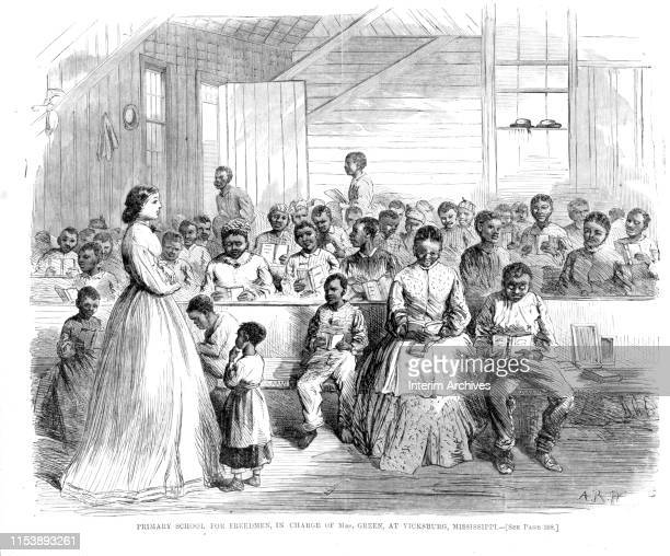 Illustration, titled 'Primary School For Freedmen, in the Charge of Mrs Green, at Vicksburg, Mississippi, 1866. It depicts a crowded classroom, with...