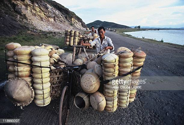 Illustration Vietnam from north to south in Hue Vietnam in May 1994Nghe Tinh a salesman on the beach