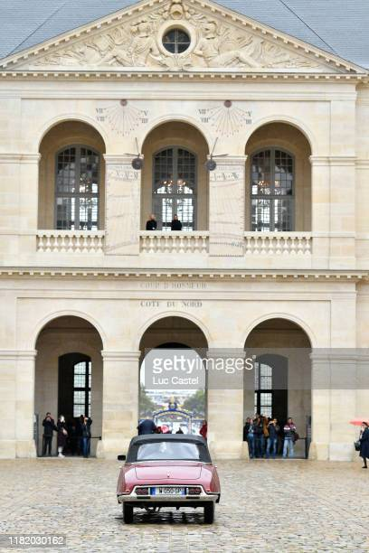Illustration view as Prince JeanChristophe Napoleon and his wife Olympia Von ArcoZinneberg come out of the Cathedral in a old DS Citroen at the end...