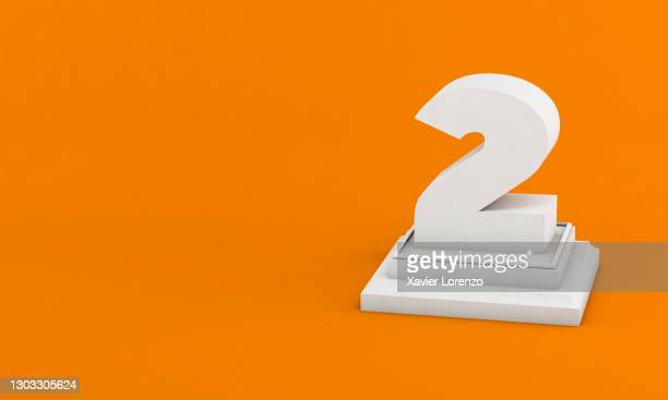 3d illustration. white number 2 on pedestal isolated on orange background - second place stock pictures, royalty-free photos & images