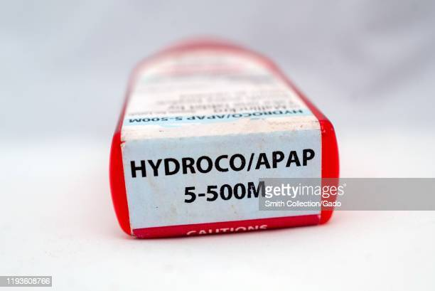 Illustrative image closeup of bottle of the combination narcotic opioid pain medication hydrocodone 5acetaminophen 500 marketed under the trade names...