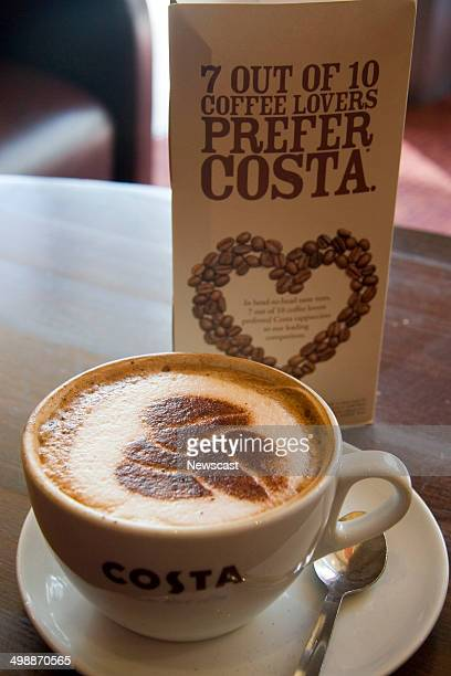 Illustrative image of a Costa Coffee cappuccino and the three bean logo