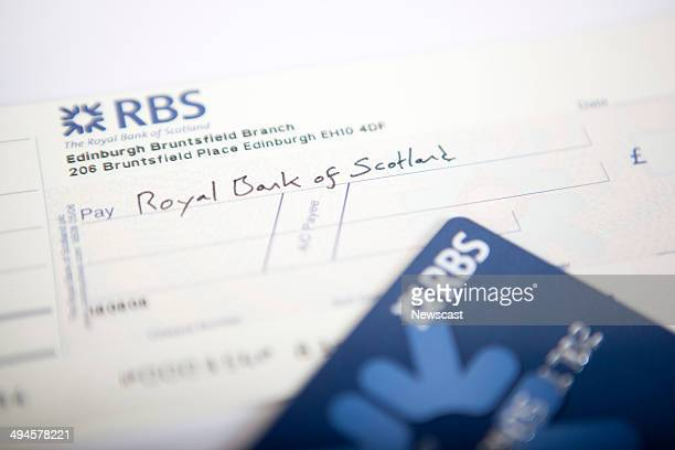 Illustrative image of an RBS cheque book and current account card