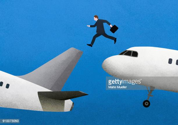 Illustrative image of businessman jumping over airplanes against blue background