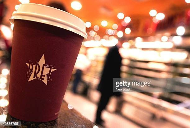 Illustrative image of Pret a Manger branded takeaway coffee cups