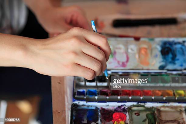Illustrator Holding Paintbrush