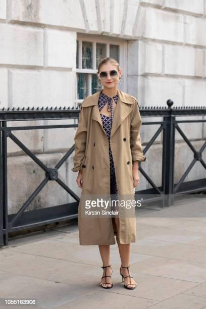 Illustrator Jenny Walton wears an Alexa Chung dress Zara coat and shoes Fendi sunglasses and Vintage earrings during London Fashion Week September...