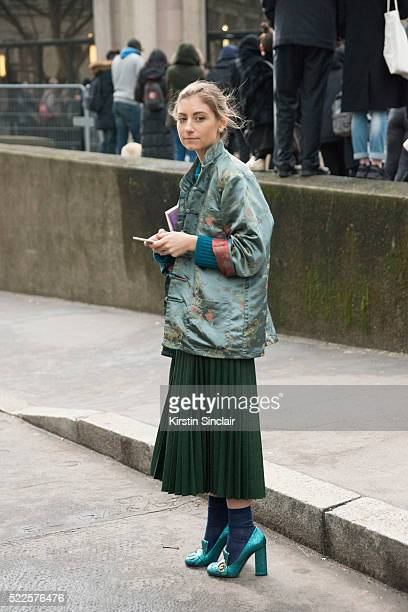 Illustrator Jenny Walton wears Gucci shoes and a vintage jacket on day 9 during Paris Fashion Week Autumn/Winter 2016/17 on March 9 2016 in Paris...