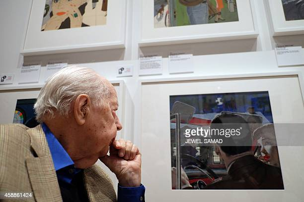 US Illustrator McCauley Conner one of New York's original Mad Men looks at his own art work during an exhibition at the Museum of the City of New...