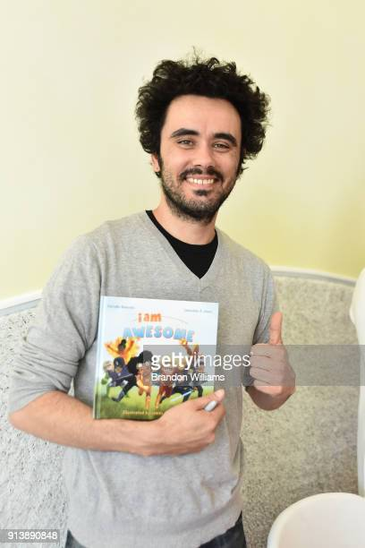 Illustrator Sebastian Jones poses with his book 'I Am Awesome' at WeVillage Flexible Childcare Center on February 3 2018 in Sherman Oaks California