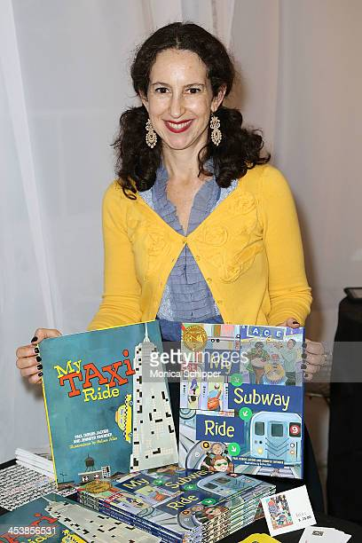 Illustrator Selina Alko poses with her work at 'love art give a smile' Art Fashion And Design Benefit at Clen Gallery on December 5 2013 in New York...